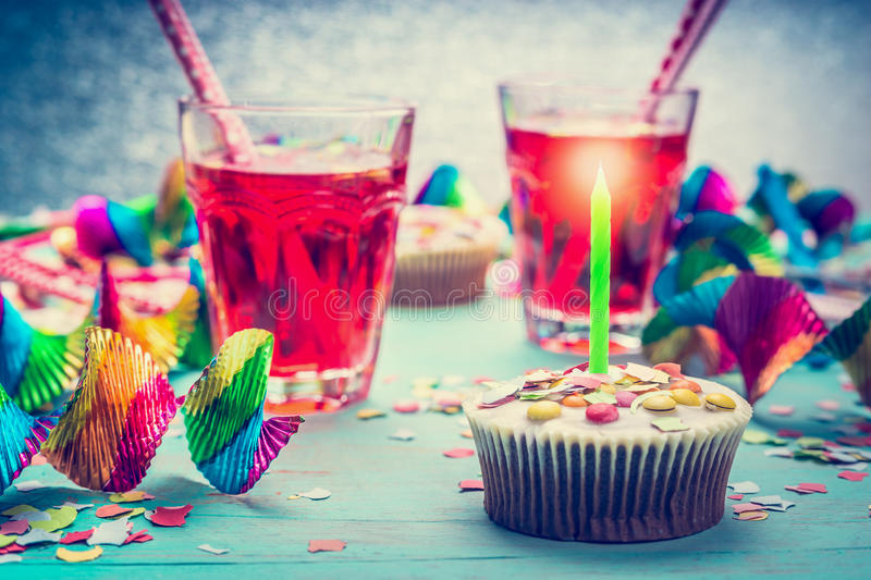 Birthday with cake, candle, drinks and party tools. stock photo