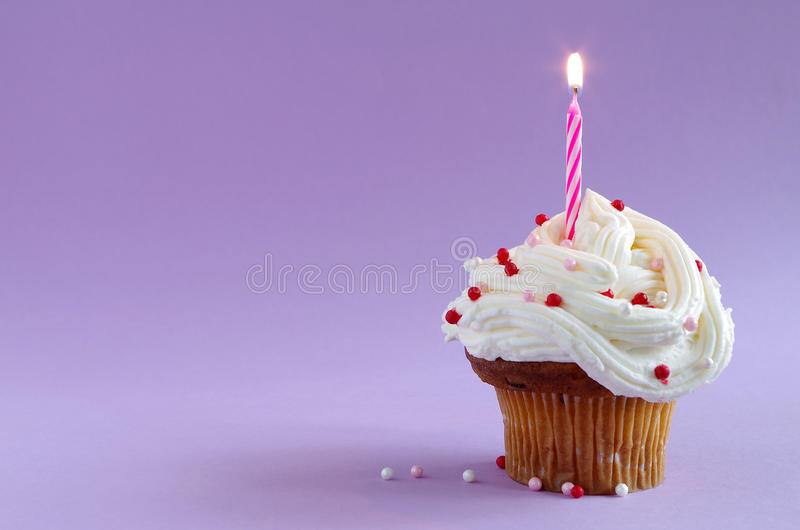 Birthday cake. A birthday cake with candle of a lilac background royalty free stock photo