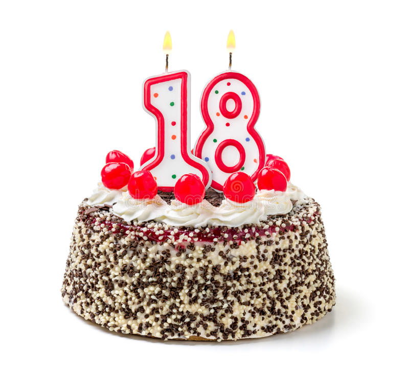 Birthday cake with candle number 18. Birthday cake with burning candle number 18 stock photo
