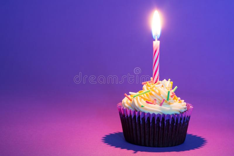 Birthday cake and candle. In purple royalty free stock photography