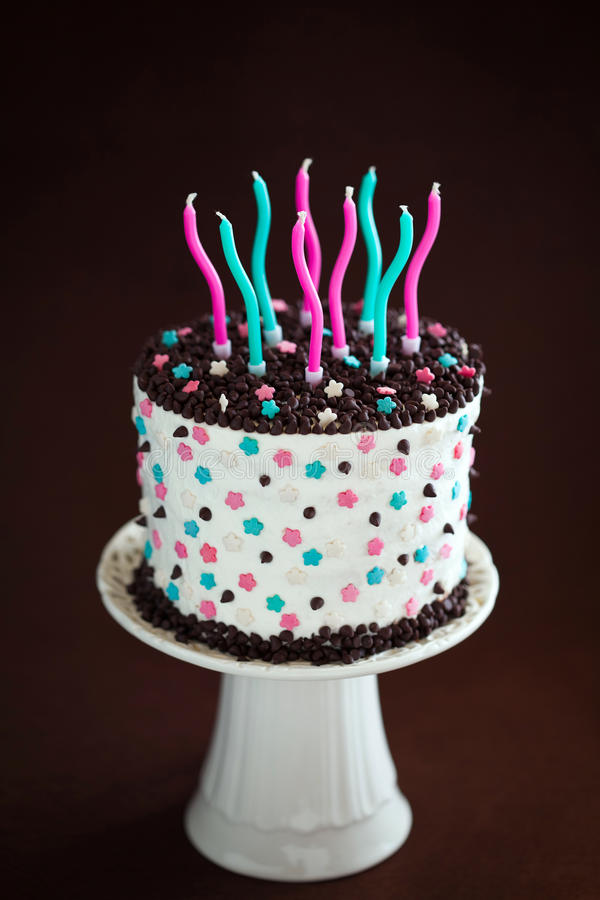 Birthday cake with candles. On cakestand royalty free stock image