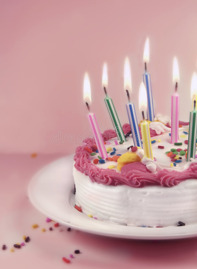 Birthday Cake and Candles. On a pink background royalty free stock photography