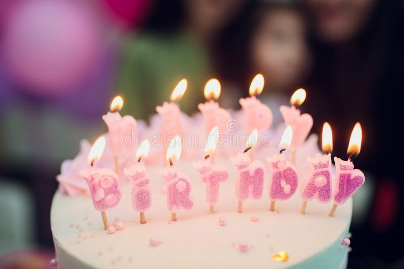 Birthday cake with candles, bright lights bokeh.  royalty free stock photos