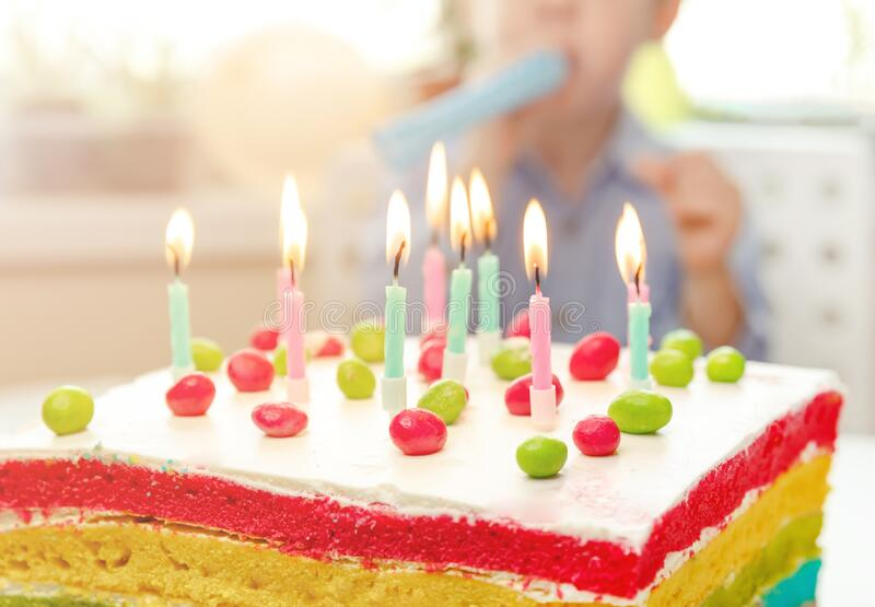 Birthday cake with candles. Happy birthday. Colored candles burn. On the cake. The children made a cake for their mother. Burning candles. Festive colorful stock image