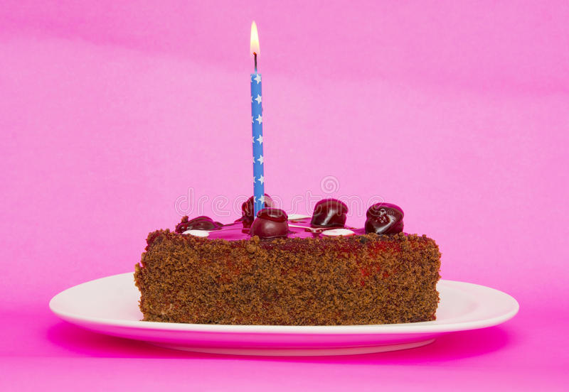 Birthday cake with candles on pink background royalty free stock photos