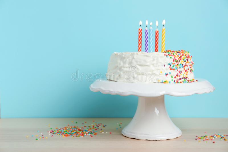 Birthday cake with candles on table stock photo