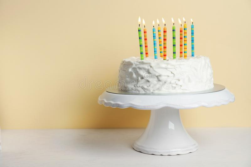 Birthday cake with candles on table royalty free stock image