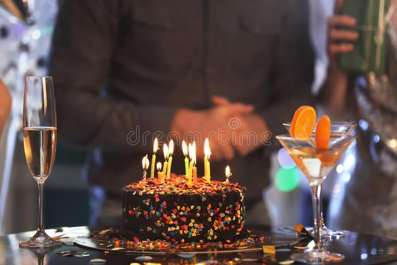 Birthday cake with candles on table at party in club royalty free stock photos