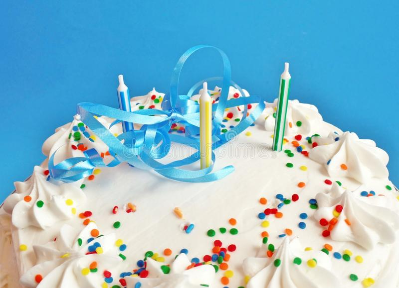 Birthday cake with candles. Birthday cake with white icing and candles royalty free stock photography