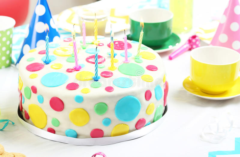 Birthday cake. With candles on wooden table stock image