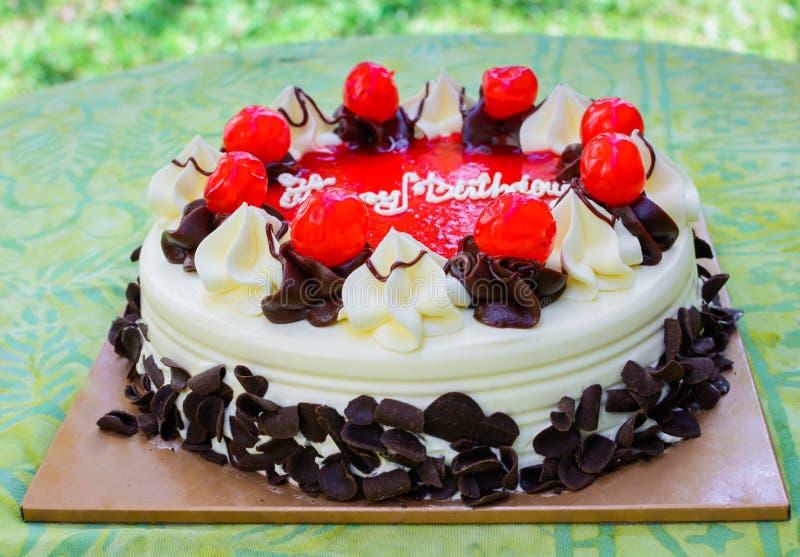 Birthday cake. Birthday chocolate cake with strawberry jam stock photo
