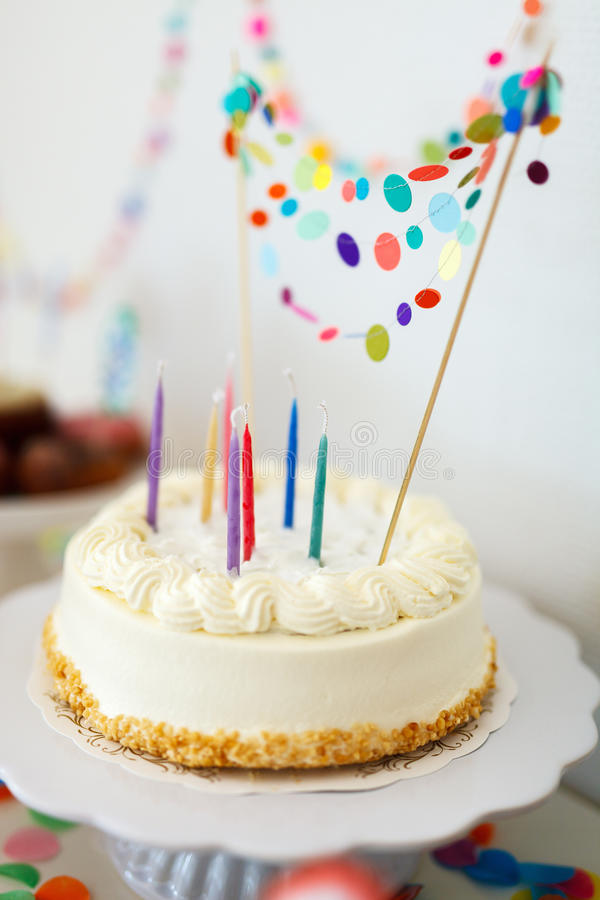 Birthday cake. Close up of a delicious birthday cake decorated with colorful confetti royalty free stock photography