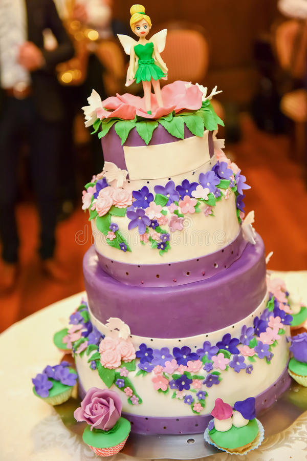 Birthday cake colored. In natural light royalty free stock photo