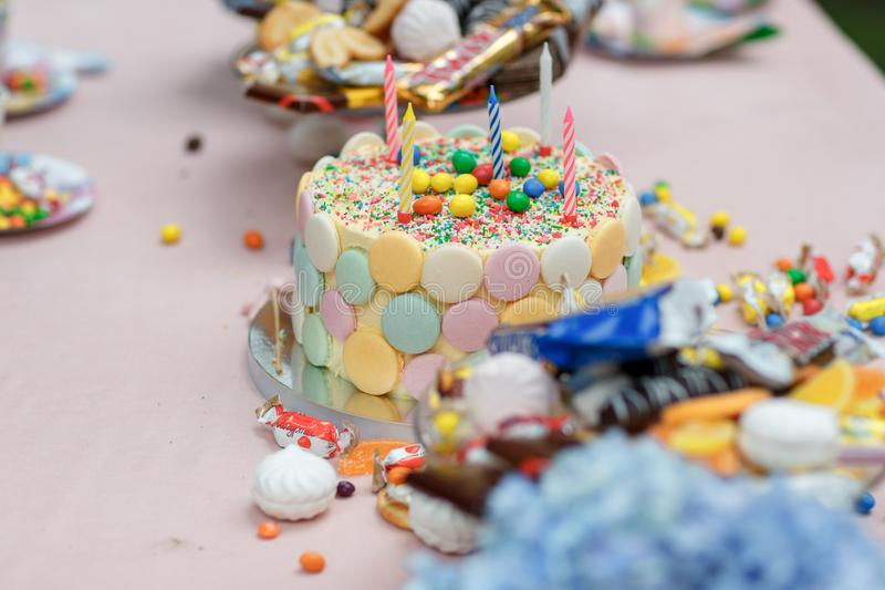 Cake birthday candles with letters in vintage style royalty free stock image
