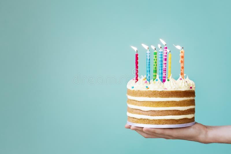 Birthday cake with colorful candles. Birthday cake with buttercream and colorful candles stock photography