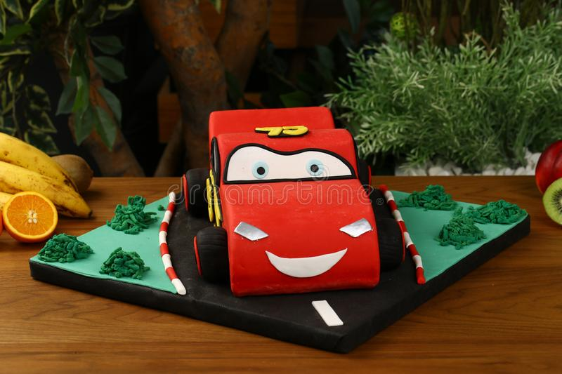 Kids birthday party cake - car consept. Birthday cake decorated with car, way stock photography