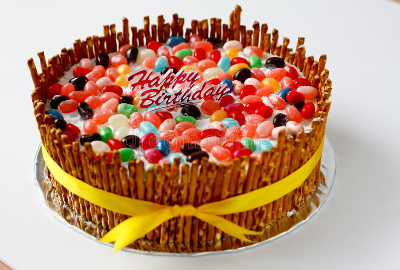 Birthday cake. Decorated with colorful jelly beans royalty free stock photos
