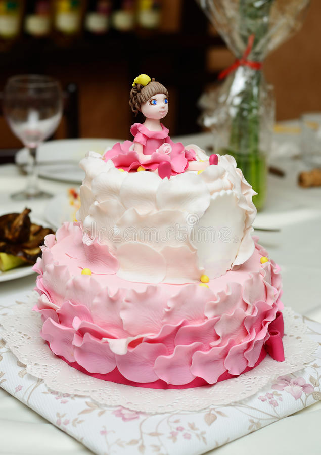 Birthday cake decorated with fondant. With girl on the top stock photography