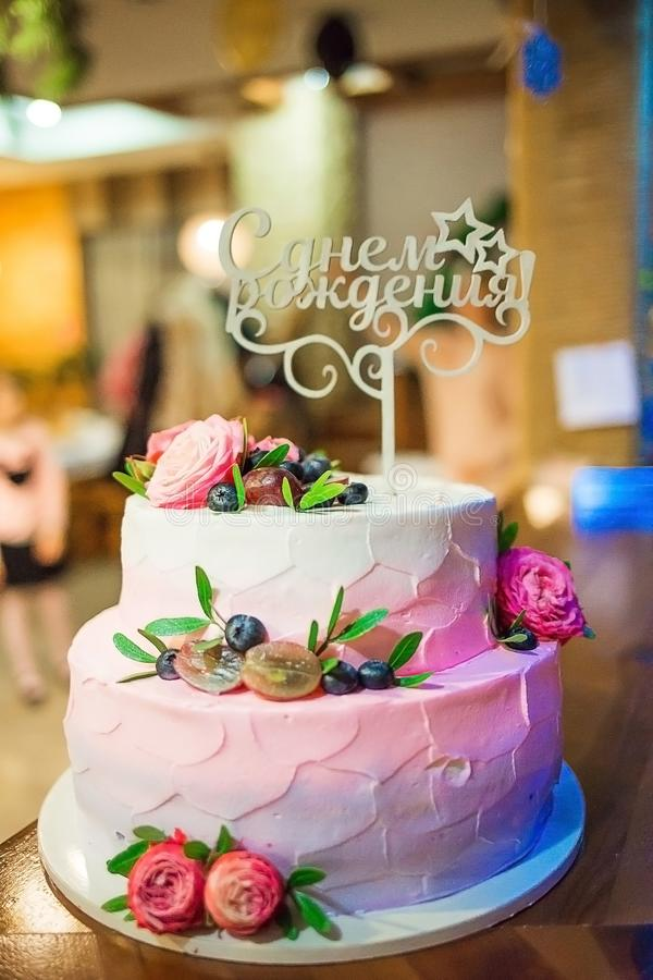 Birthday cake decorated by fruits stock photography