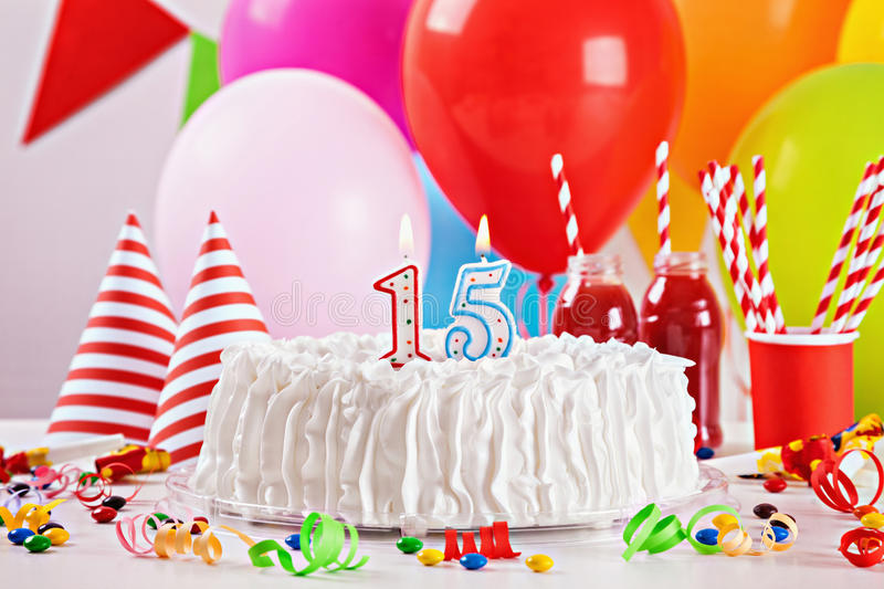 Birthday Cake And Decoration. Birthday Cake On Colorful Balloon Background With Other Birthday Decoration. Focus is on cake royalty free stock photography