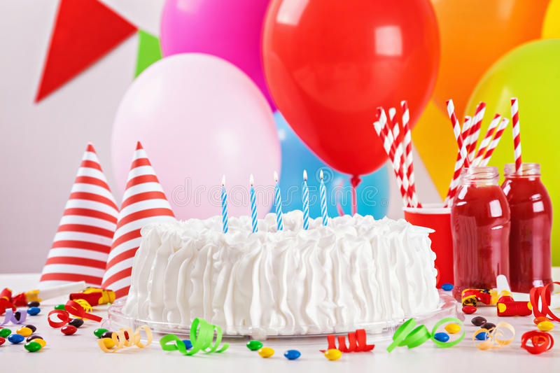 Birthday Cake And Decoration. Birthday Cake On Colorful Balloon Background With Other Birthday Decoration. Focus is on cake stock image