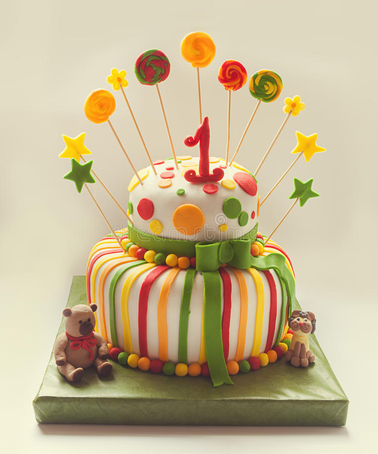 Birthday Cake. Details of birthday cake, colorful decoration and number one on top royalty free stock image