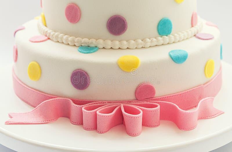 Birthday cake. Details of a birthday cake, isolated on white background stock photo