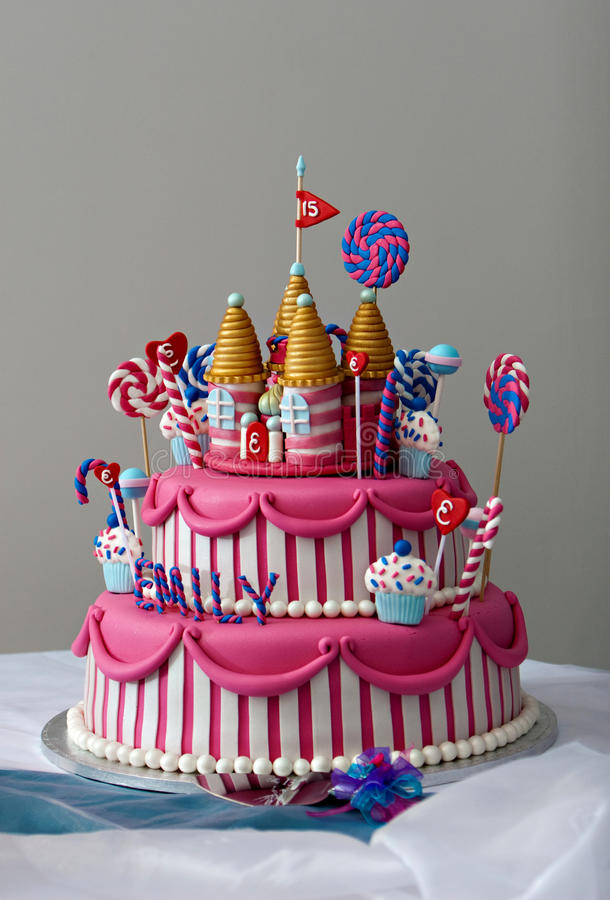 Birthday Cake. A fancy birthday cake with a candyland theme. The three layer cake is covered with fondant and candy decorations stock photos