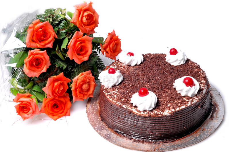 Birthday cake and flowers stock image