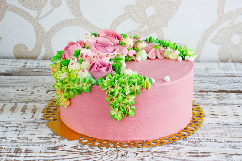 Birthday cake with flowers rose on white background.  royalty free stock image