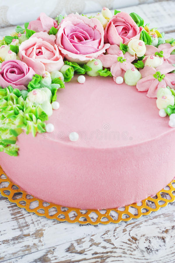 Birthday cake with flowers rose on white background.  stock photography