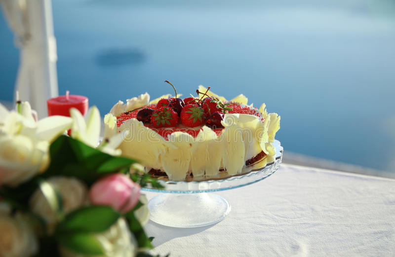 Birthday cake with fruits. On a background of the sea royalty free stock image