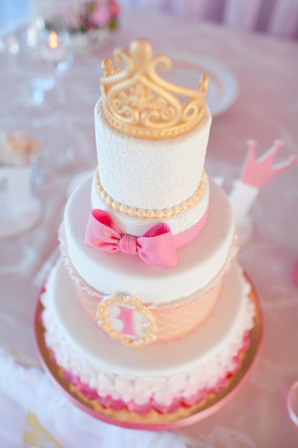 Birthday cake. With golden crown on top closeup. Wedding day. Decorations royalty free stock photo