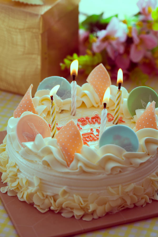 Birthday cake. With the light colorful candles stock photo