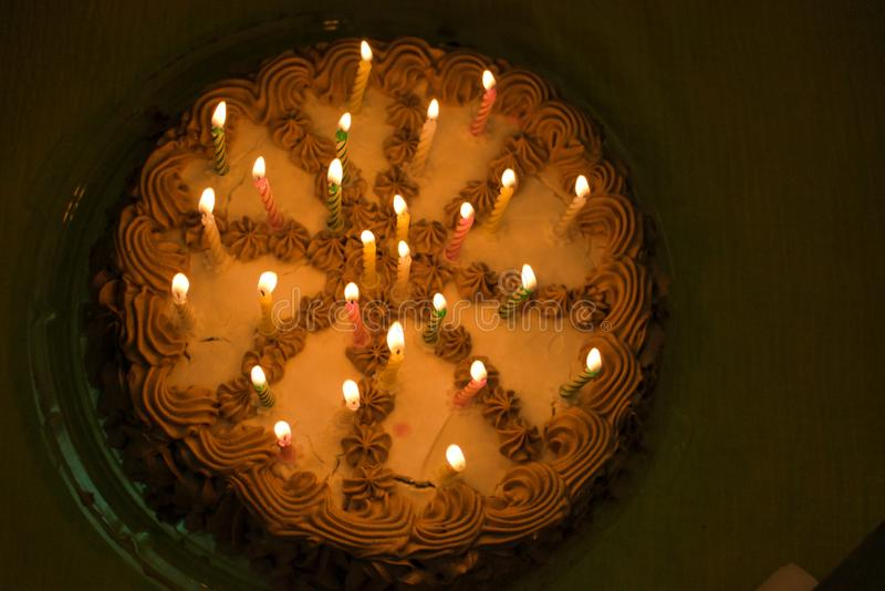 Birthday Cake. With lit candles royalty free stock photography
