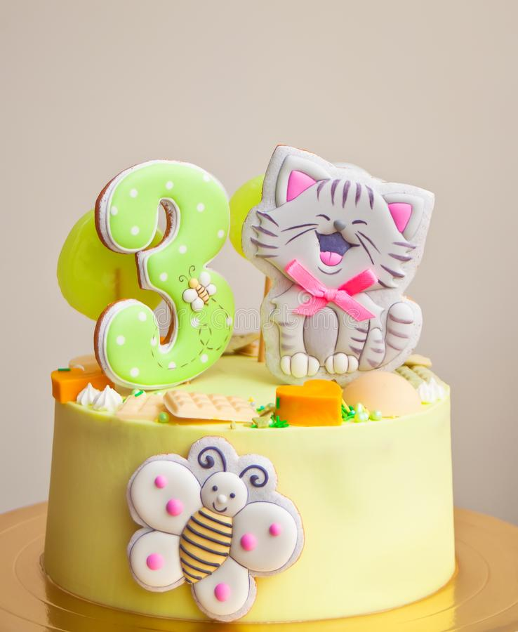 Birthday cake for little girl decorated funny cookies with cat and butterfly stock photos