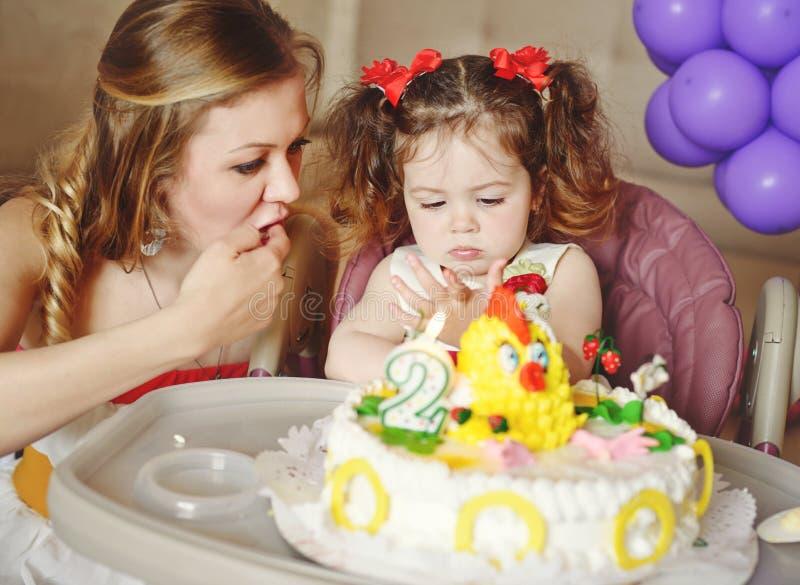 Birthday cake. Of little sweet toddler girl stock photography