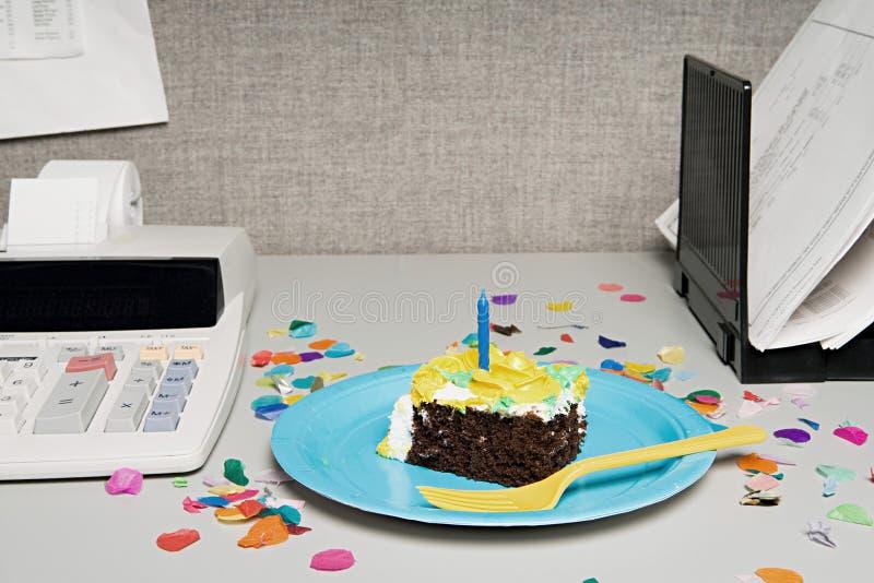 Birthday cake on an office desk stock image