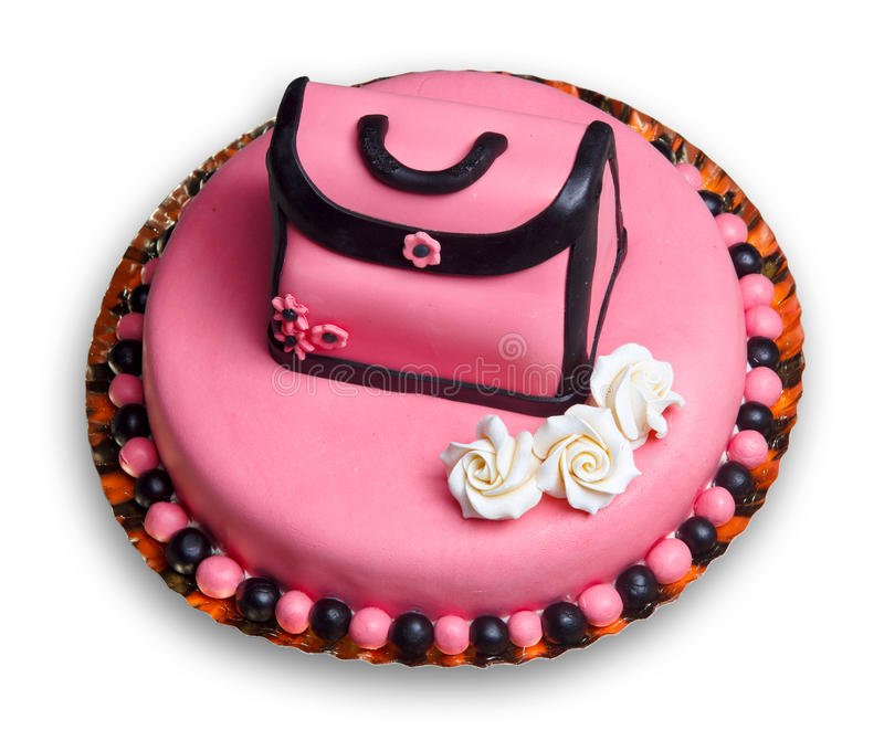 Birthday cake with pink frosting,decorated handbag. Birthday cake with pink frosting,decorated with a vintage woman handbag and flowers including three roses stock photos