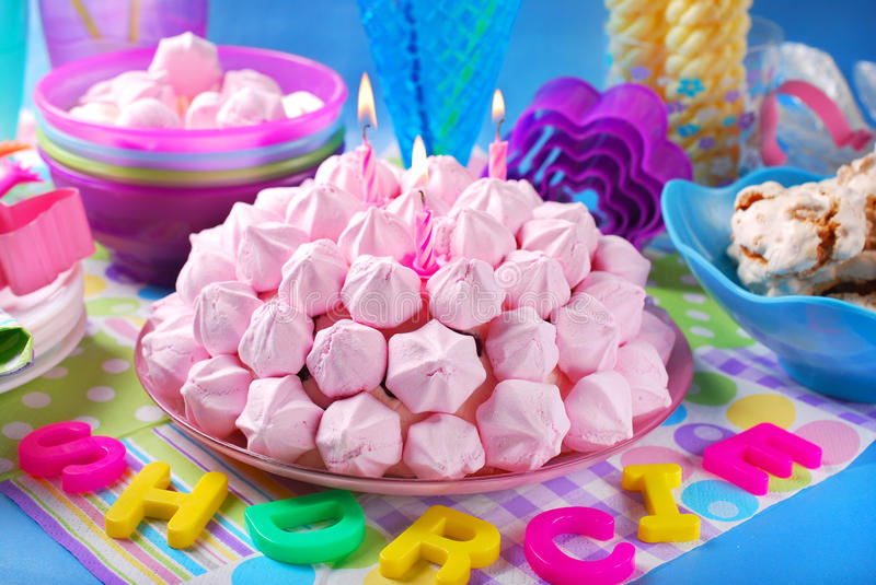 Birthday cake with pink meringues and candles stock photos