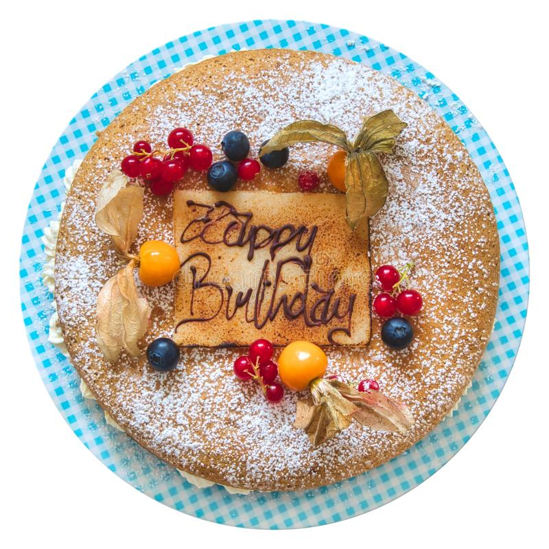 Birthday cake with piped message in chocolate writing with the words `happy birthday` isolated against a pure white background stock photos