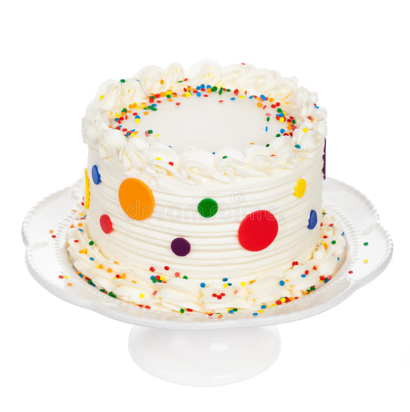 Birthday Cake. With polka dot fondant, buttercream icing and sprinkles isolated on white royalty free stock images