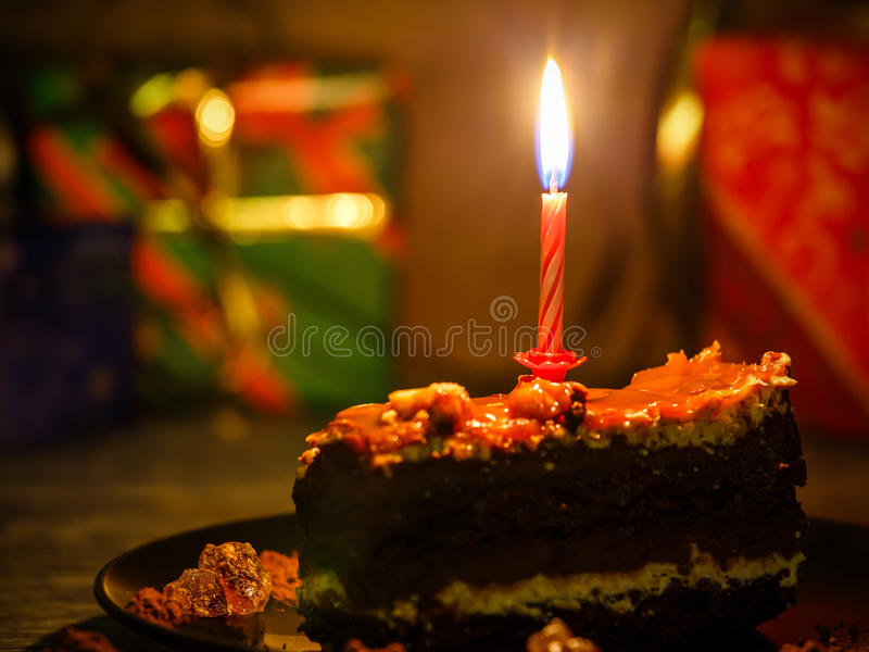 Birthday cake. With presents in the background royalty free stock photo