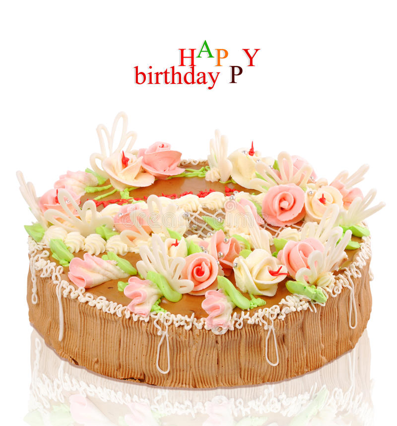 Birthday cake with roses on a white background. The birthday cake with roses on a white background royalty free stock photography