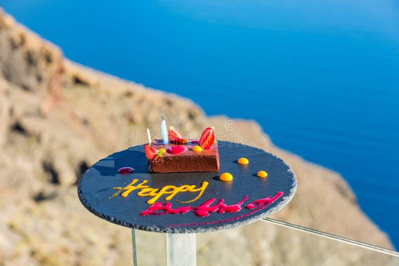 Birthday and cake on the sea royalty free stock photos