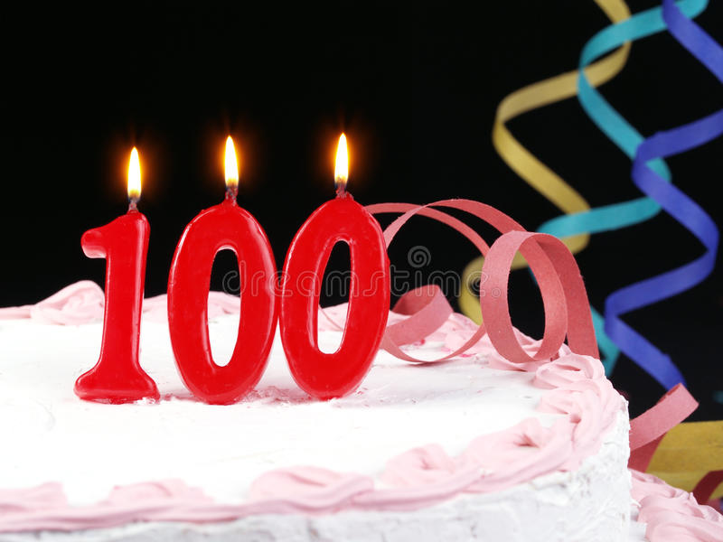 Birthday cake showing Nr. 100. Birthday cake with red candles showing Nr. 100 stock image