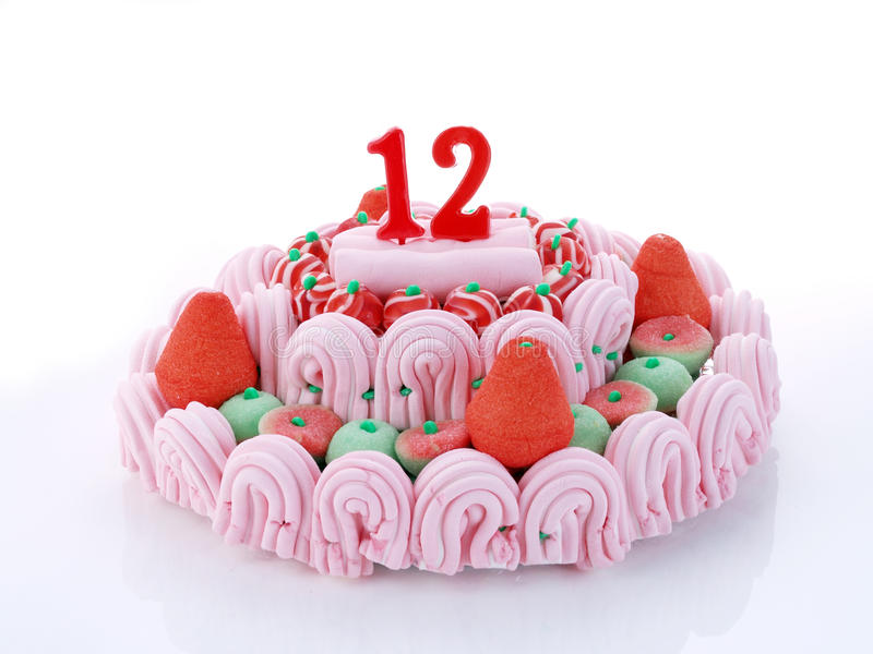 Birthday cake showing Nr. 12. Birthday cake with red candles showing Nr. 12 royalty free stock photo