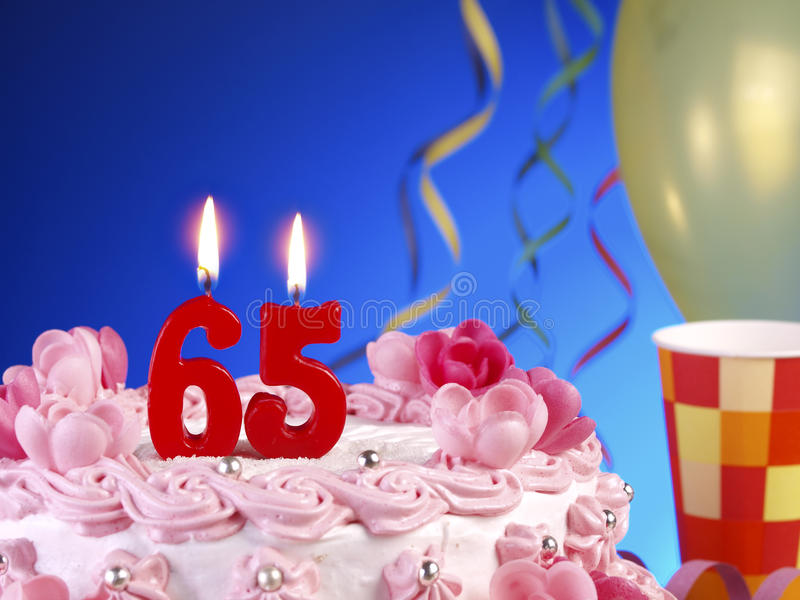 Birthday cake showing Nr. 65. Birthday cake with red candles showing Nr. 65 stock image