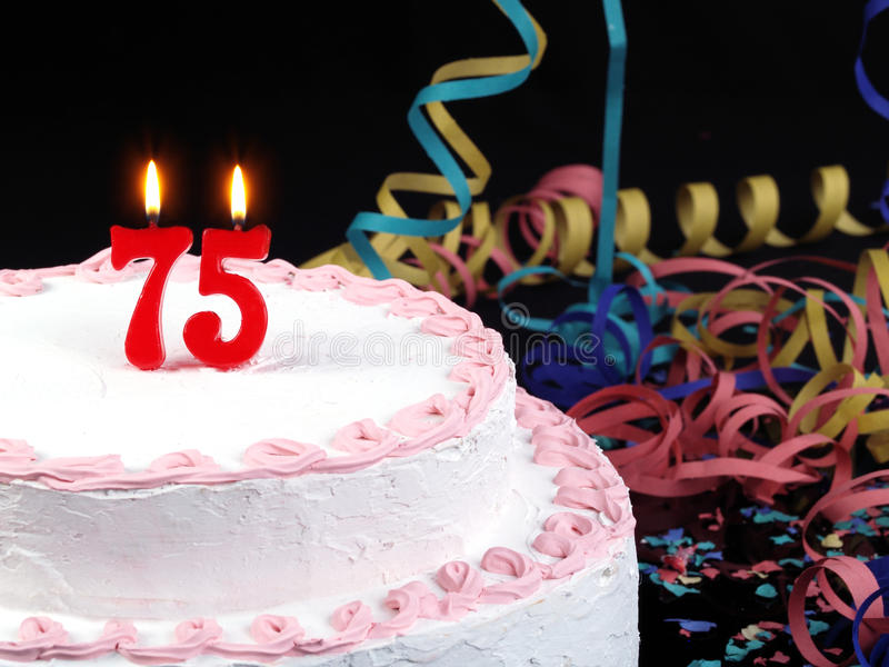 Birthday cake showing Nr. 75. Birthday cake with red candles showing Nr. 75 stock photo