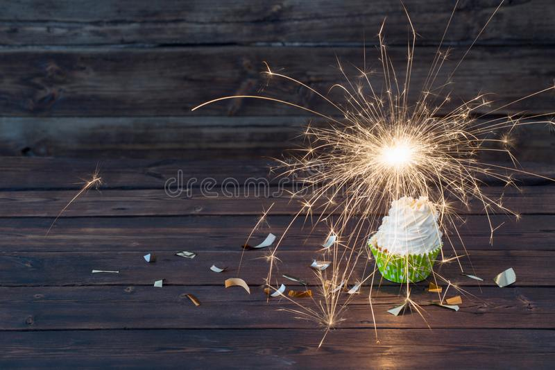 Birthday cake with sparkler on  wooden background royalty free stock images
